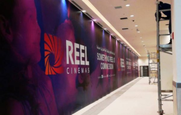 Large format wall branding for Reel Cinema at Springs mall